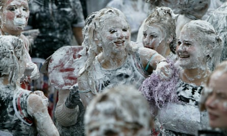 Freshers celebrate their initiation to St Andrew's University with the traditional foam fight.