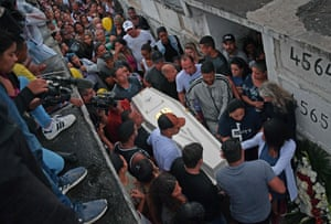 Rio de Janeiro, Brazil: Relatives carry the coffin of eight-year-old Agatha Sales Felix, who was killed by a stray bullet during a police operation at the Alemao complex.