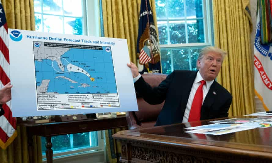 Donald Trump presents an official government weather map altered with a Sharpie to change the projected path of Hurricane Dorian.