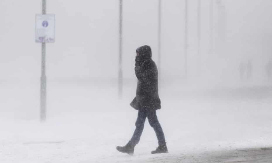 A walk along a snow-covered Portobello beach during a snow storm