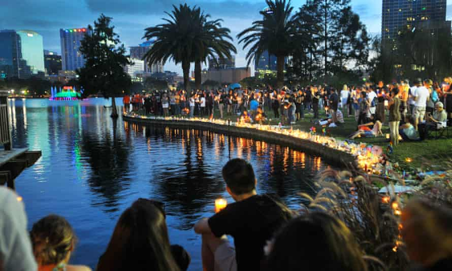People hold candles at a candlelight vigil for the victims of the mass shooting at Pulse nightclub, as they gather at Lake Eola Park in Orlando.