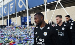Leicester's players pay their respects to Vichai Srivaddhanaprabha outside the ground.