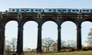A Thameslink train crosses a viaduct