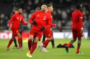 Alex Oxlade-Chamberlain warms up before returning to the starting line up.