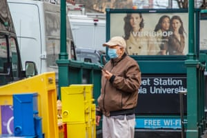 A man wears a surgical mask in the street near the University of Colombia in New York city