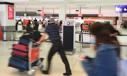 A Qantas check-in area at Sydney international airport this week. Restrictions on foreign travel have been implemented in Australia as the coronavirus outbreak worsens.