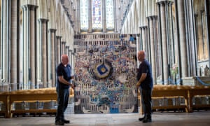 Salisbury cathedral caretakers Steve and Tony Marshall as they move part of The Miracle Paintings series into place.