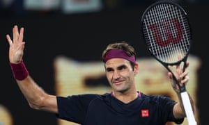 Roger Federer waves after winning the match against Serbia's Filip Krajinovic.