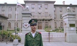 A policeman guards the US embassy in Beijing on 13 June 1989, while dissident Fang Lizhi was taking shelter there