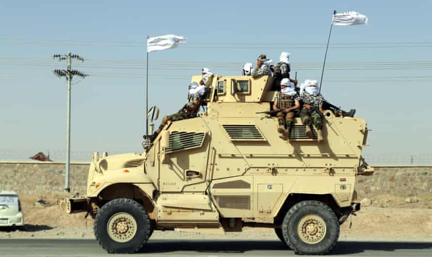 Taliban forces rally to celebrate the withdrawal of US forces in Kandahar.