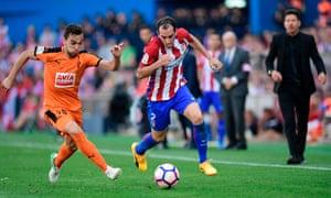 Diego Godín gallops forward.