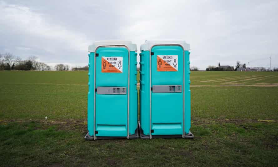 Portable toilets in a field