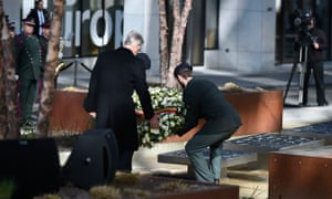 King Philippe lays a wreath during the inauguration ceremony for the memorial for the Brussels attacks.