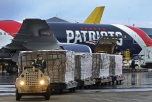 Pallets of N95 respirator masks from China are offloaded from the New England Patriots football team's jet at Logan airport in Boston, US