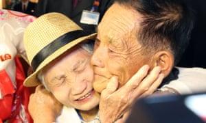 South Korean Lee Keum-seom (L), 92, meets her North Korean son Ri Sung Chol (R), 71