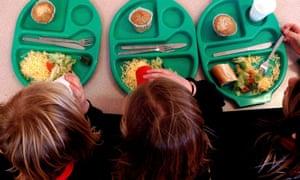 Schoolchildren eat school meals