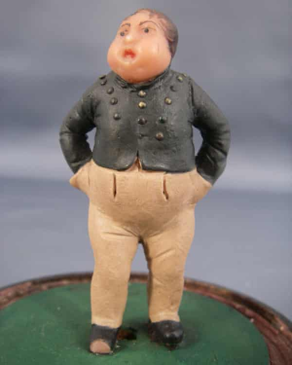 A figurine of the 'fat boy' from The Pickwick Papers.