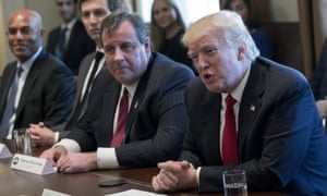 Chris Christie sits next to Donald Trump in a White House briefing about the opioid crisis, as Jared Kushner, second left, watches on.