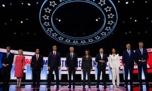 Candidates Tulsi Gabbard and Andrew Yang, third and fourth from right, on the second night of the second round of Democratic primary debates, in Detroit last week