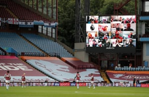 Aston Villa fans on the big screen react to a missed chance.