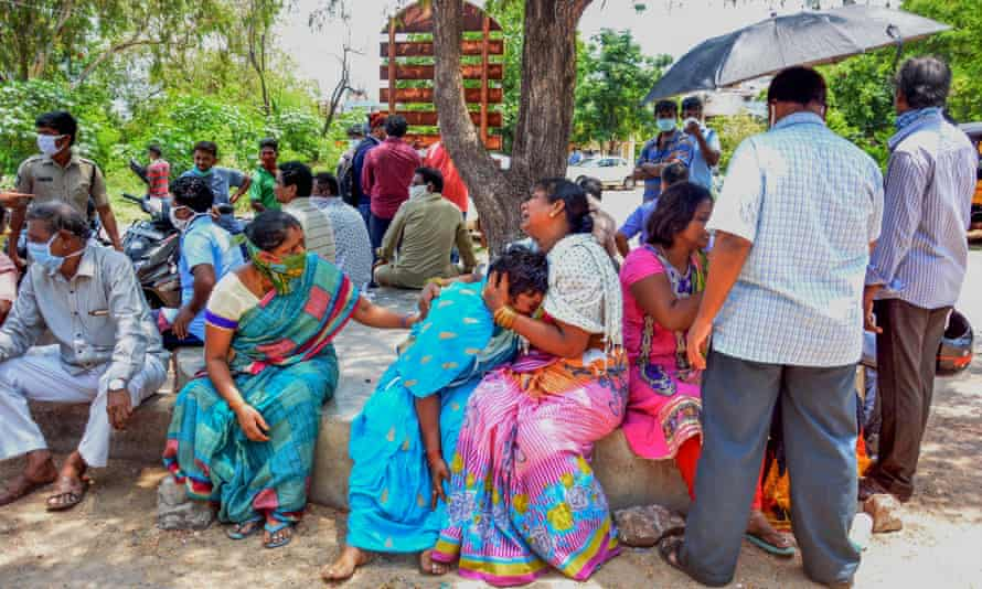 Friends and relatives gather outside a hospital mortuary in Visakhapatnam to mourn those who died following a gas leak incident atthe city's LG Polymers plant.