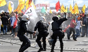 Protesters clash with police during the protest in Brasilia on Wednesday.