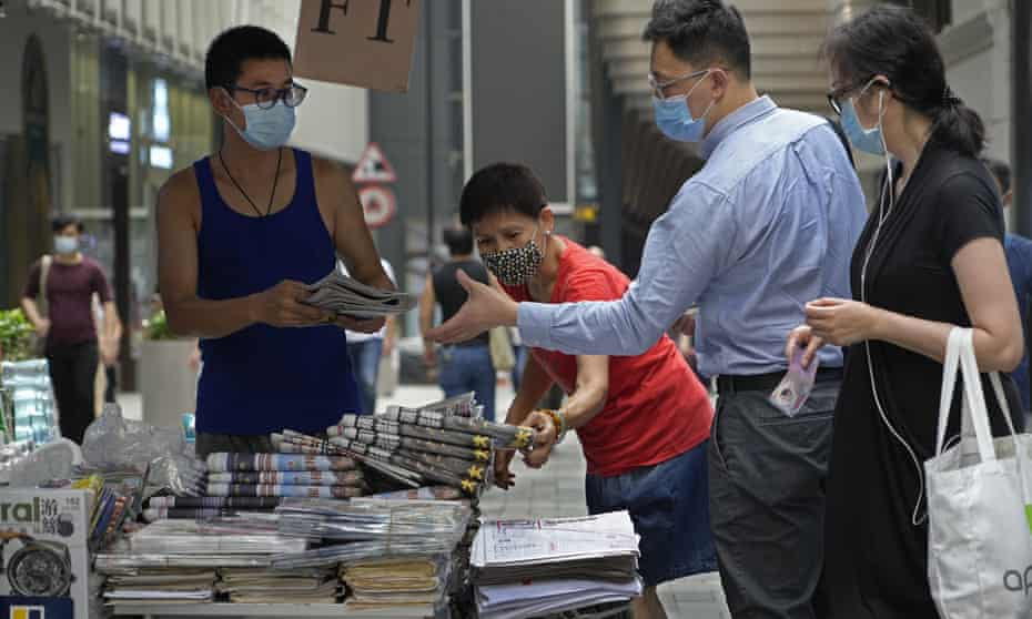 People queue up to buy Apple Daily on 18 June 2021.