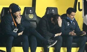 A forlorn Tottenham bench with manager Mauricio Pochettino holding his head.