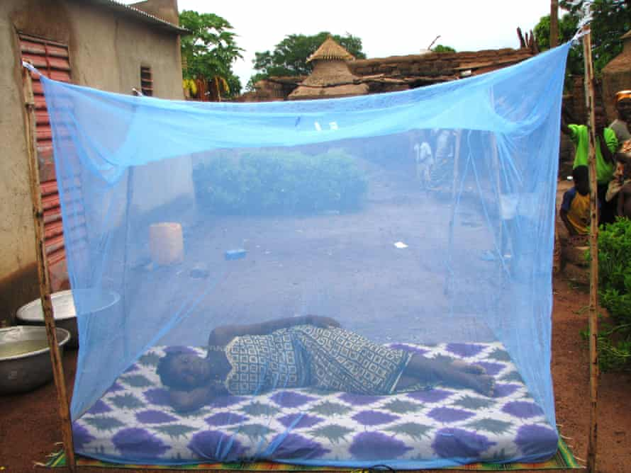 Villagers in Burkina Faso often sleep outside because of the heat, raising the risk of mosquito bites.