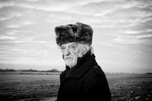 Black and white image of elderly man in Russian hat