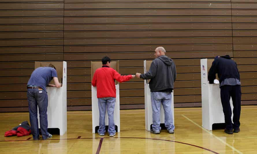 Midterms Elections Held Across The U.S.<br>HAMTRAMCK, MI - NOVEMBER 4: Voters fill out their ballot at a polling station during the mid-term elections November 4, 2014 in Hamtramck, Michigan. Today Americans head to the polls to cast their vote in the mid-term elections, which will decide whether Republicans or Democrats will control the Senate. (Photo by Joshua Lott/Getty Images)