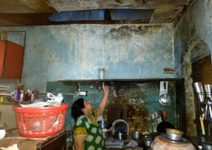 Heena Tolani points to a section of collapsed ceiling in the kitchen of her Mumbai home.