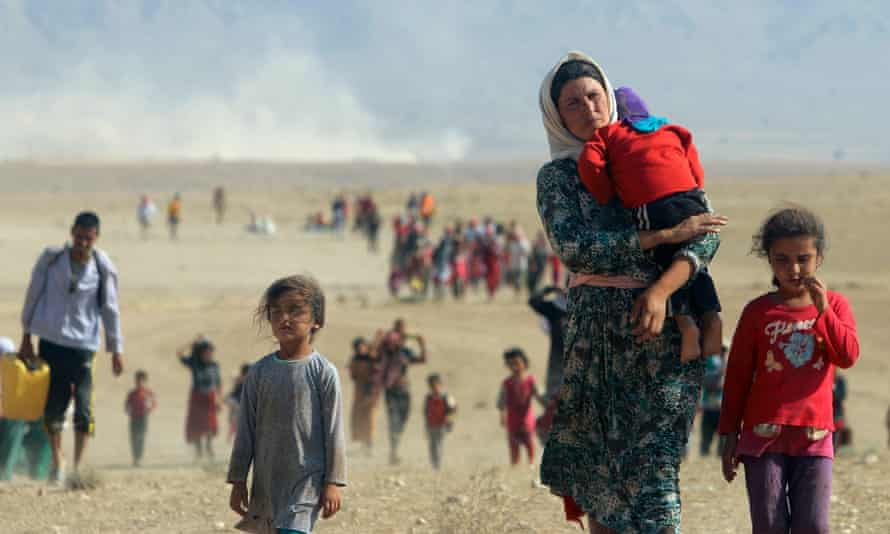 Yazidis fleeing violence from forces loyal to Islamic State in Sinjar in Iraq.