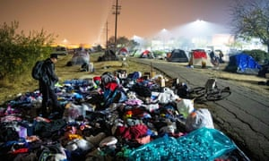 Evacuees sift through a pile of clothing at an evacuee encampment in a Walmart parking lot in Chico, California, at the weekend.