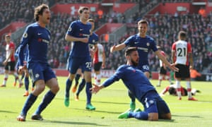 Olivier Giroud celebrates on his knees as his team-mates join him after putting Chelsea 3-2 ahead at Southampton