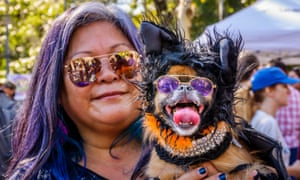 A woman with her dog, dressed up for Hallowen