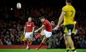 Wales' Dan Biggar kicks a penalty.