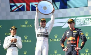 Valterri Bottas with the Australian Grand Prix trophy after winning at Albert Park in Melbourne at the Formula One season opener.