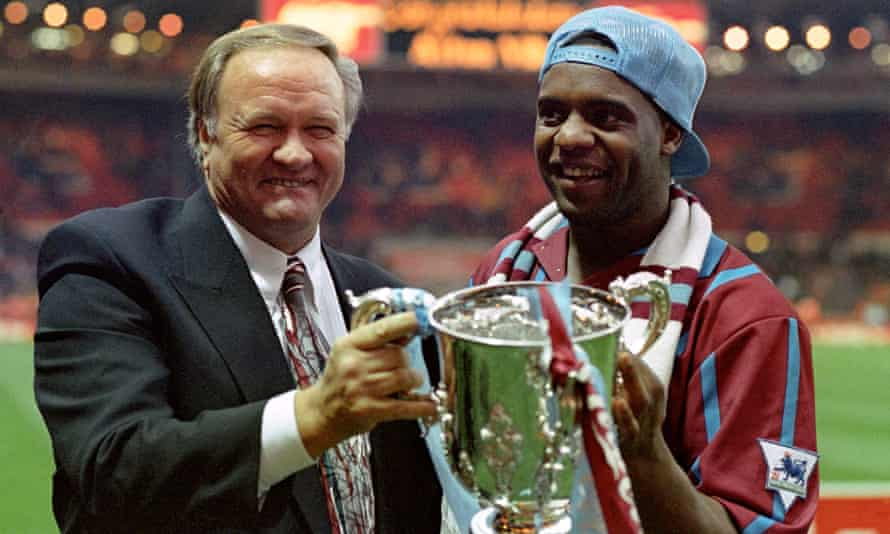 Atkinson and Aston Villa manager Ron Atkinson holding the Coca-Cola Cup in 1994.