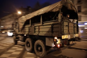 Soldiers are taken in a truck to adopt combat positions in St-Denis