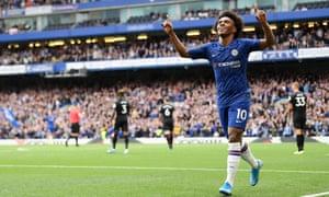 Willian celebrates after scoring Chelsea's second goal against Brighton.