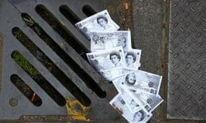 money falling down a drain