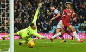 Aston Villa's Robert Snodgrass, centre,  steers the ball  past the Bristol City goalkeeper Luke Steele for his second goal during the 5-0 win.