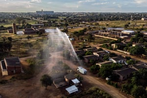 Bulawayo, Zimbabwe A police water cannon is used to spray hydroperoxide compound to disinfect a market in Nkulumane township in Bulawayo