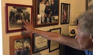 Jataun Valentine viewing family portraits in the Venice house her grandfather built.