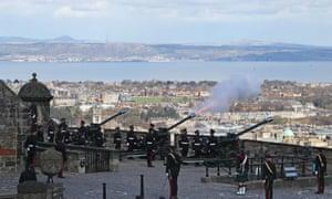 Members of the 105th Regiment Royal Artillery fire a 41-round gun salute at Edinburgh Castle.