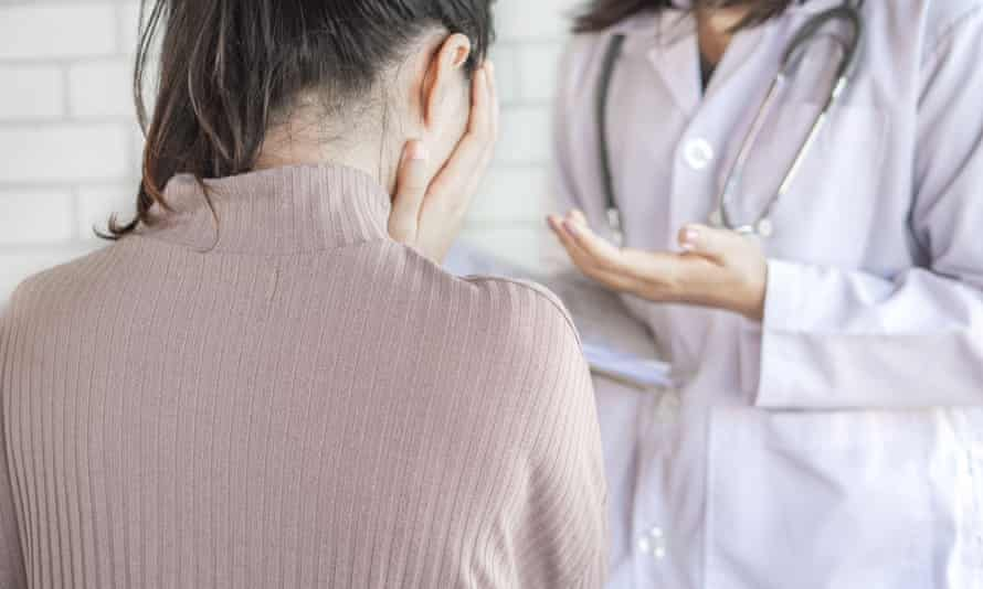 Doctor talking and explaining the treatment result to female patient that shocked and crying with bad news