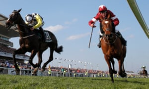 Tiger Roll, right, wins the Grand National by a fast-diminishing margin from Pleasant Company at Aintree.