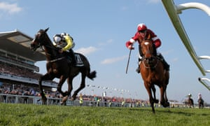 Tiger Roll (right) ridden by Davy Russell just beats Pleasant Company and David Mullins in a photo-finish