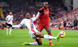 Aaron Wan-Bissaka dispossesses Liverpool's Naby Keïta at Anfield.